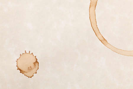 coffee stain isolated on a parchment paper background photo