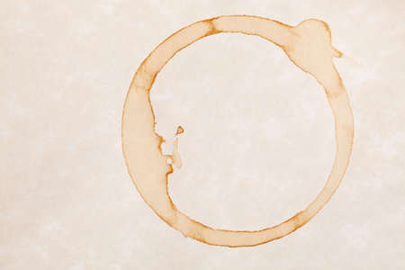 coffee ring stains on white parchment paper background photo