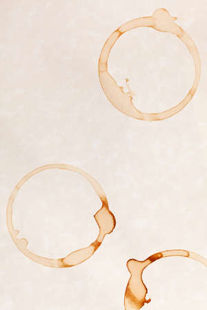 coffee ring stains on white parchment paper background