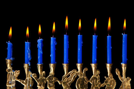burning hanukkah candles in a menorah on black background Stock Photo - 7963078
