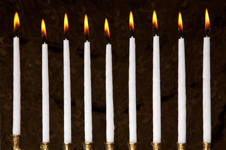 burning hanukkah candles in a menorah on black background Stock Photo - 7963084