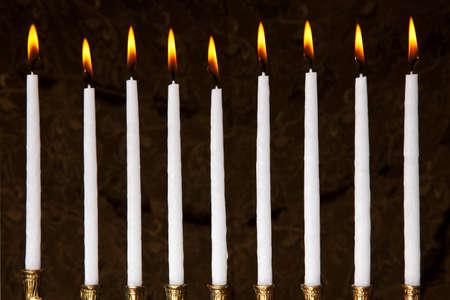 burning hanukkah candles in a menorah on black background Stock Photo - 7963084