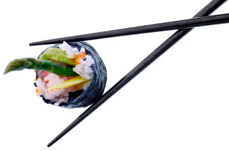 chopstick: Sushi roll with black chopsticks isolated on white background