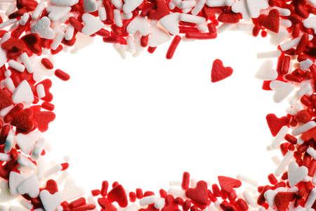 Valentine heart sprinkles isolated on white background photo