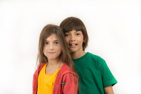 Girl and boy posing on white background photo