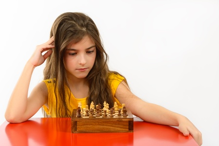 girl thinking a chess game isolated on white background