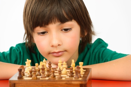 boy thinking a chess game isolated on white background photo