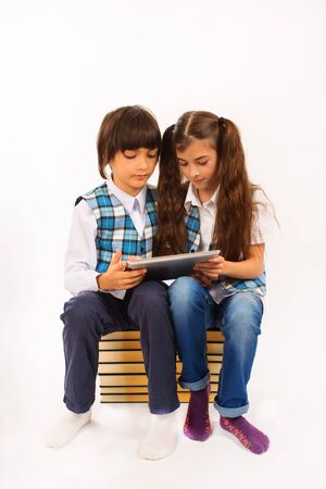 two school children who are struggling for tablet pc photo