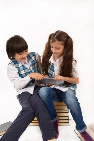 two school children who are struggling for tablet pc Foto de archivo