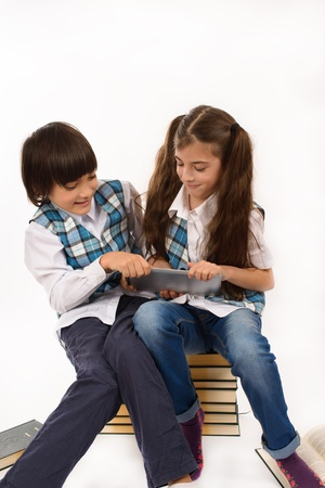 two school children who are struggling for tablet pc Stock Photo