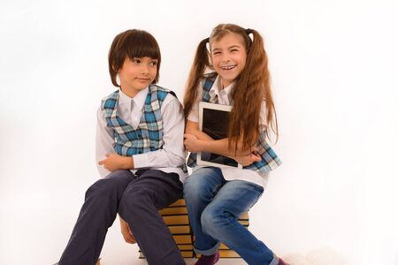 two school children who are struggling for tablet pc Stock Photo - 16301744
