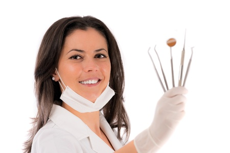 A young dentist with a tool on a white background photo