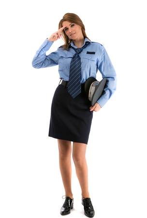 Beautiful lady in a uniform of police officer on a white background Foto de archivo