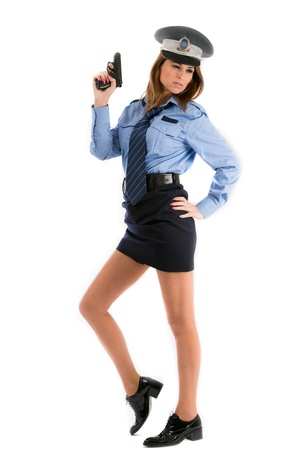 Lady cop posing with gun on white background photo