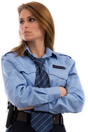 Beautiful lady in a uniform of police officer on a white background photo