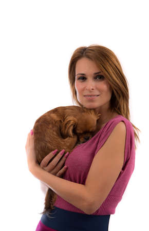Portrait of young attractive blonde woman holding little dog on her hands Stock Photo