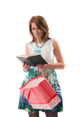 shoppings: a lady at shoppings reading a book Stock Photo