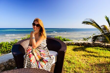 beautiful woman relaxing on the shore of the ocean photo