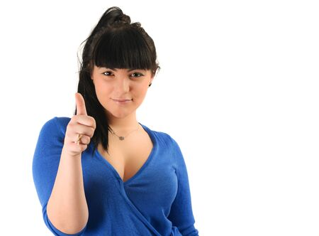 resilient: Young brunette woman indicating ok sign Stock Photo