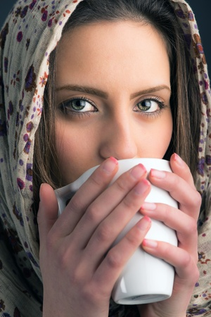 portrait of a beautiful young woman drinking coffee photo