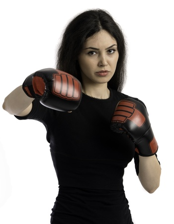 Young girl over black background with boxing gloves photo