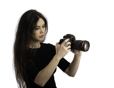 The beautiful girl with the camera, isolated on a white background Stock Photo - 18355204