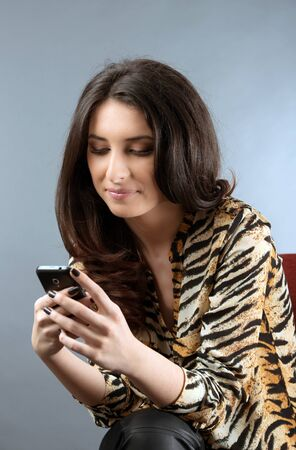 young woman checking his phone messages