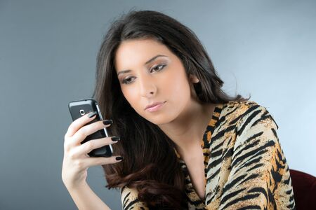 young woman checking his phone messages Stock Photo - 18730859