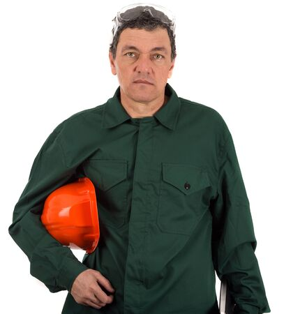 portrait of a workman in overalls and helmet isolated on white background photo