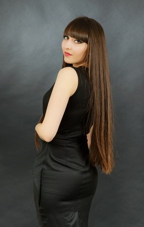 Portrait of a young beautiful woman with bangs in studio Stock Photo