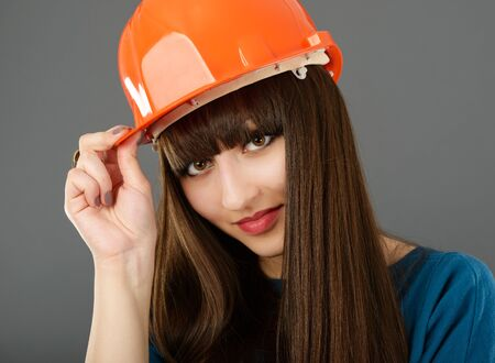 Businesswoman with construction helmet. Isolated on gray Stock Photo - 19050599
