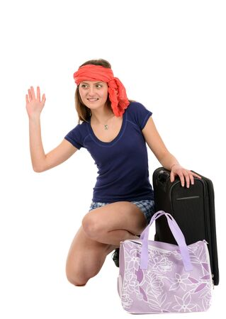 a beautiful tourist woman with baggage showing sign isolated on white background photo