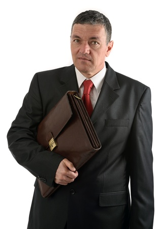 Older businessman with briefcase isolated on white background photo