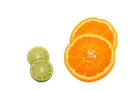 lime and orange cut in half isolated on white background photo