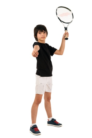 portrait of a handsome boy with a tennis racket isolated on white background photo