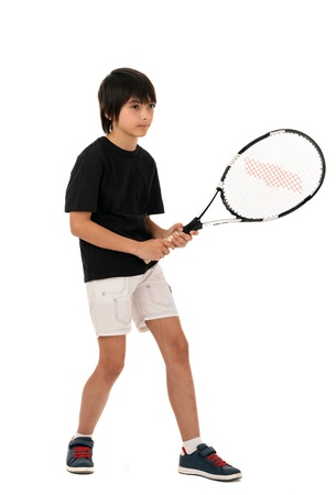 portrait of a handsome boy with a tennis racket isolated on white background Stock Photo