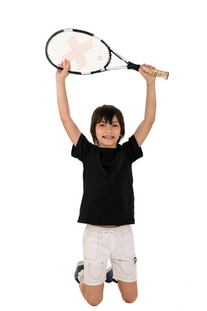 preteen model: portrait of a handsome boy with a tennis racket isolated on white background Stock Photo