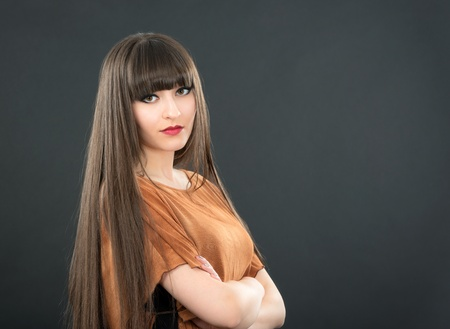 studio portrait of attractive young woman with long hair Stock Photo