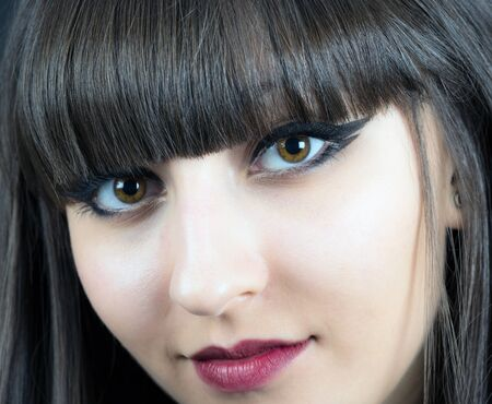 Close-up face of beautiful young woman  on black background Stock Photo - 19499349