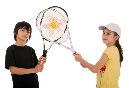 two happy children posing with tennis racquets on white background photo