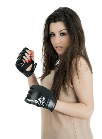 Young sexy girl over white background with boxing gloves photo