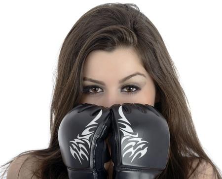 tough: Muchacha atractiva joven sobre fondo blanco con guantes de boxeo Foto de archivo