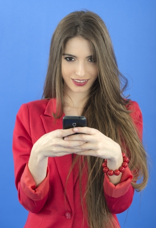 Young businesswoman talking on smart phone photo