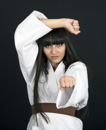 karateka: karateka asian girl on black background studio shot Stock Photo