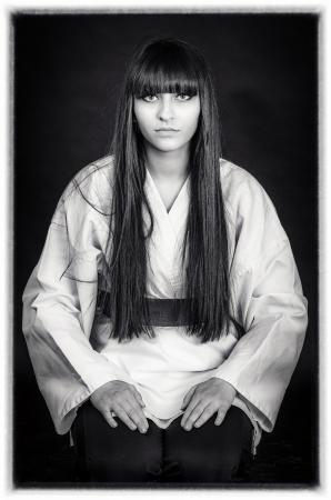 sensei: karateka asian girl on black background studio shot Stock Photo