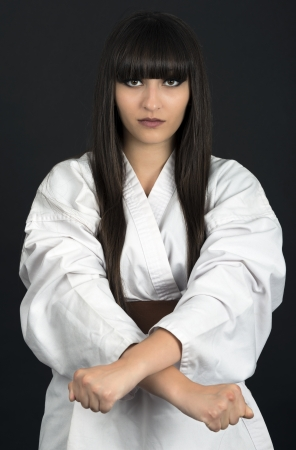 karateka asian girl on black background studio shot photo