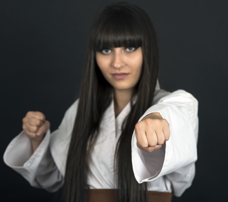 martial artist: karateka asian girl on black background studio shot Stock Photo