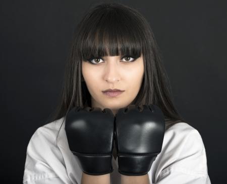 karateka asian girl on black background studio shot photo