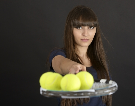 Female tennis player with racket and ball on black background Stock Photo - 20082297