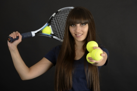 Female tennis player with racket and ball on black background Stock Photo - 20082311